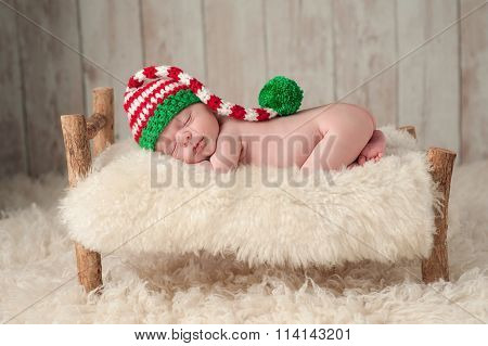 Newborn Baby Boy Wearing A Christmas Elf Hat