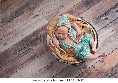 Newborn Baby Boy Wearing A Pixie Hat