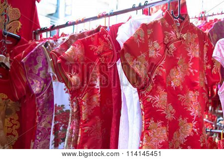 Qipao, Cheongsam,  Or Chinese National Dress Sell On The Street At China Town. People Look And Buy F