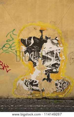 ROMA-ITALY SEPT 26, 2015: Old worn stencil of a woman on a wall in Roma, Italy