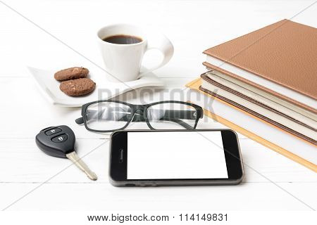 Coffe Cup With Cookie,phone,car Key,eyeglasses And Stack Of Book