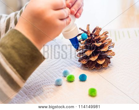 Closeup of Young Child Gluing a Craft