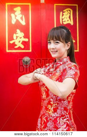 Happy Chinese New Year. Cute Asian Woman With Gesture Of Congratulation Isolated