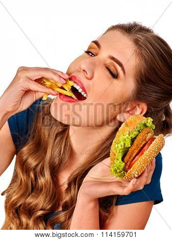 Young beautiful woman eating  big pizza.