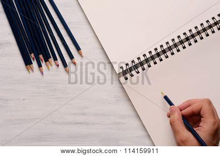 Man Drawing In Blank Sketchbook