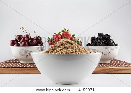 Homemade Granola And Cherries, Strawberries, And Blackberries In The Background