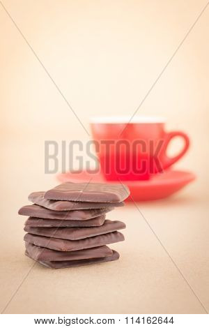 Red Mug Of Hot Coffee And Chocolate Pieces