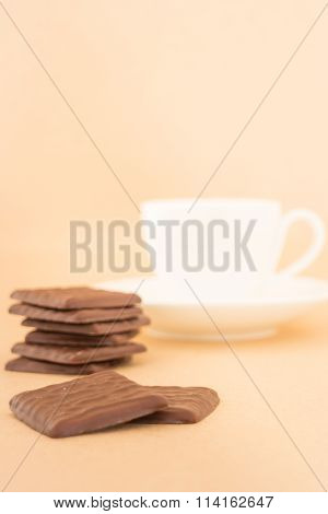 White Mug Of Hot Coffee And Chocolate Pieces