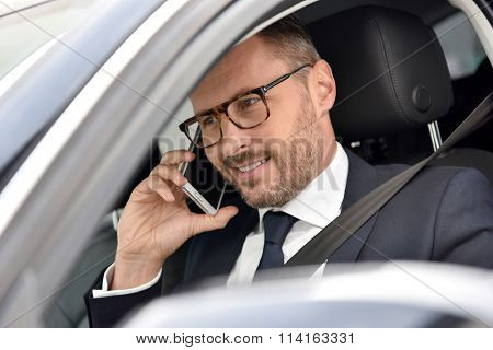 Taxi driver receiving phonecall from client