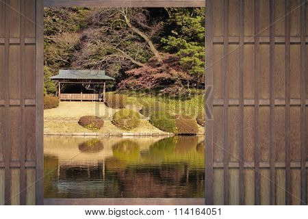 Japanese house window with Japanese garden in autumn season