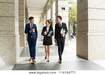 Group of business people walking on the street