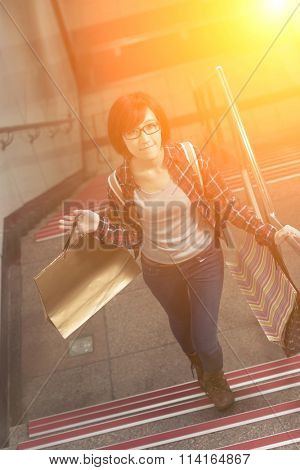 Attractive woman walk up on stair in Taipei, Taiwan.