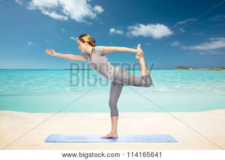 woman making yoga in lord of the dance pose