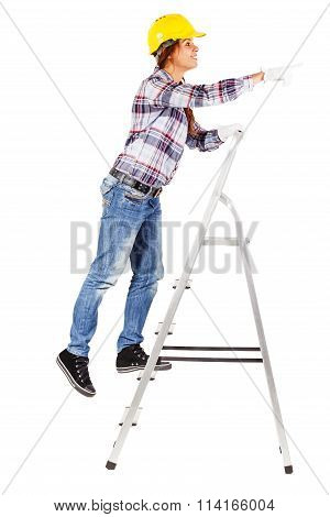 Young Worker Stands On The Stairs Looks Straight Ahead
