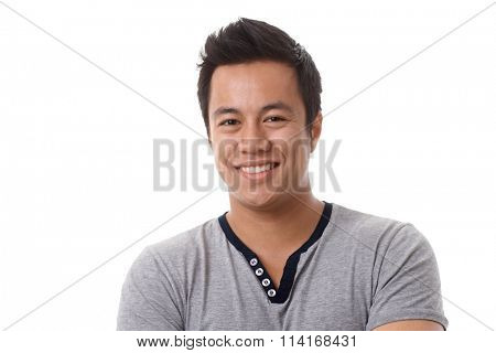 Closeup portrait of happy young Asian man smiing, looking at camera.