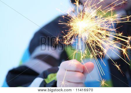 A boy with a sparkler