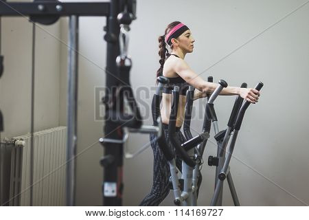 Beautiful Girl Doing Workout In The Gym
