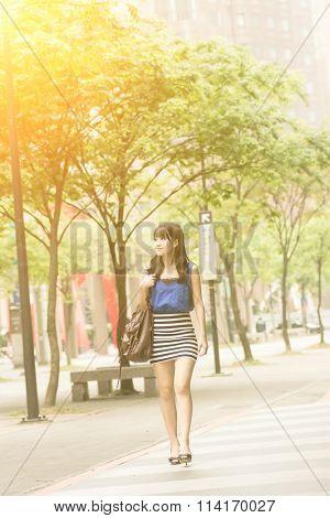 Asian beauty in daytime in modern street in Taipei, Taiwan, Asia.