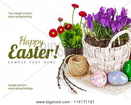 Easter eggs with spring flowers in basket. Isolated on white background