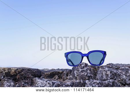 Modern Sunglasses From Blue Plastic Are Located Separately