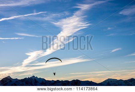 Silhouette Of Paraglide Flying Over Mountains