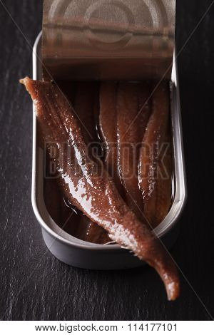 Canned Anchovy Fillets Macro On A Slate Board. Vertical