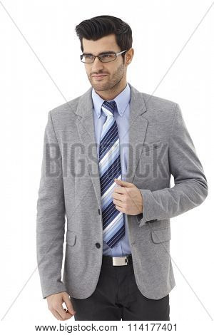 Portrait of happy confident businessman in glasses and suit.