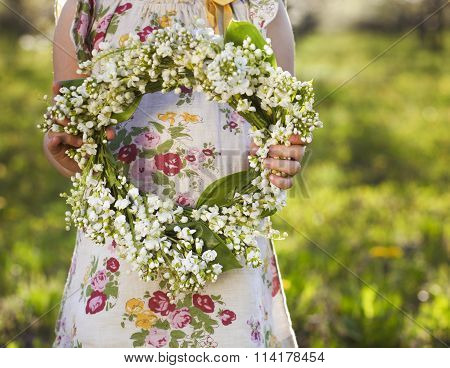 Little Girl Holding Wreath From Lily Of The Valley