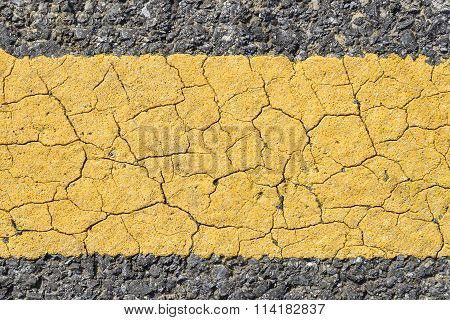 Asphalt road with yellow strip