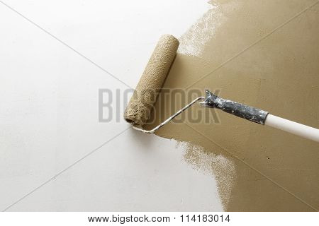 Paint Roller Applying Paint On White Wall, Home Improvements