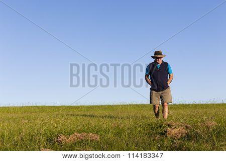 Man Walking Grass-field