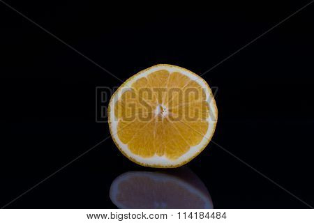 Orange half against black background
