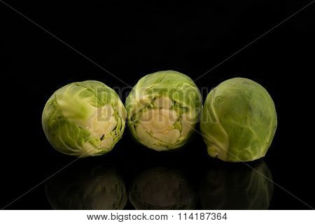 Brussels sprouts against a black background
