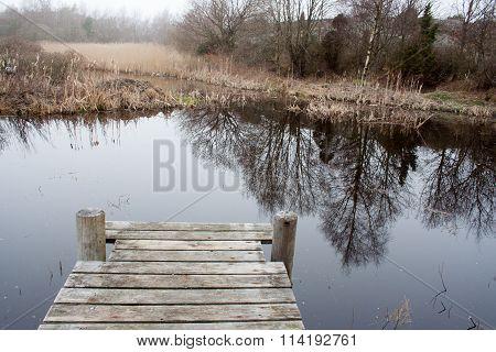 Wooden pier at small lake on swedish island
