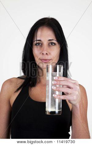 Woman drinking an effervescent tablet