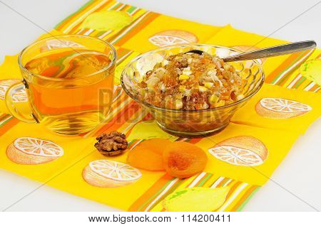 Tea With Lemon. Jam And Dried Fruits, Nuts And Dried Apricots, Honey Be Stand On The Serviette