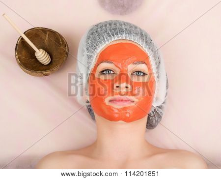 beautician does cosmetic mask on the patient's face, professional consultation.