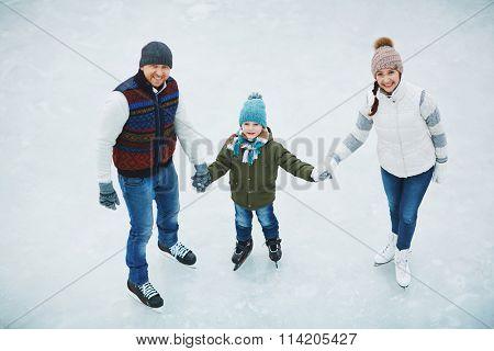 Family in skating rink