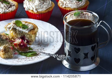 Muffin with cherry and pineapple, cup of coffee