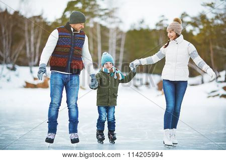 Family in outdoor rink