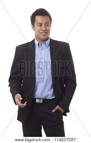 Confident young Asian businessman smiling, looking away.