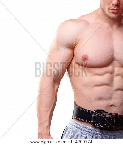 Close up shot of muscular man with lifting belt. Model over white isolated background