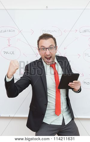 Satisfied businessman holding digital tablet