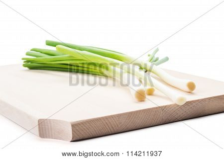 Bunch Of Spring Onions On A Wooden Plate Or Board.