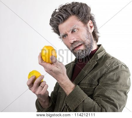 Mr. IceMan, smiling man with a beard, beard covered with hoarfrost, man holding lemon, he stares at