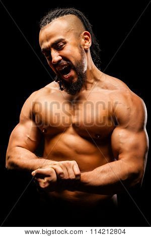 Muscular Young Man in Contrast Light on Black Background