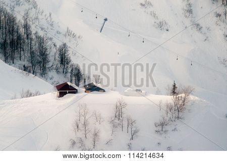 Ski Slopes And Cable Cars. Winter Mountain Landscape