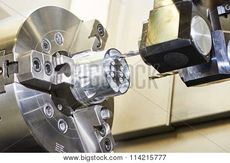 cnc metal working machining center with cutter tool during metal detail milling at factory.