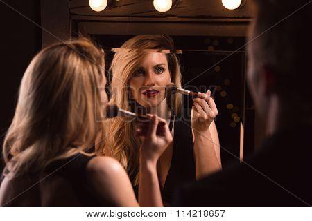 Female Lover Doing Make-up