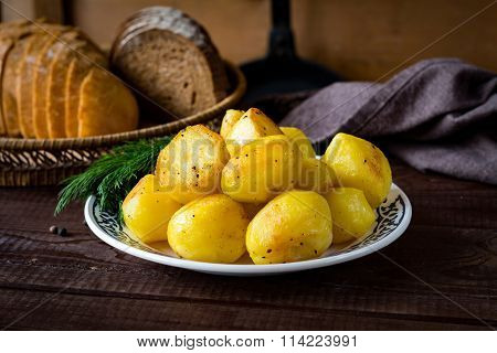 Golden roasted potatoes on plate
